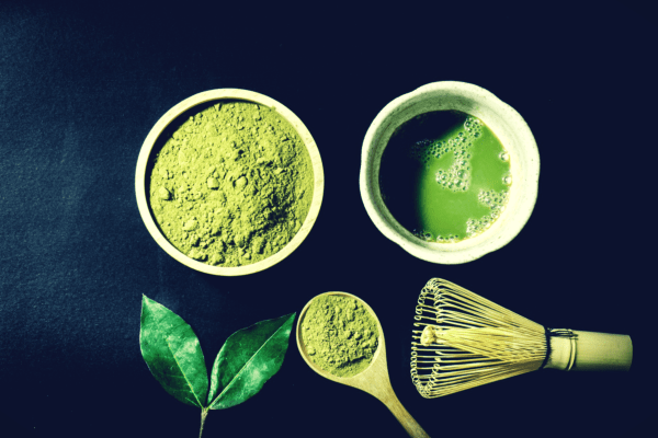 matcha powder tea with whisk and spoon