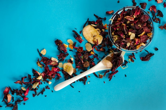 Hibiscus Tea - Putting dried flowers